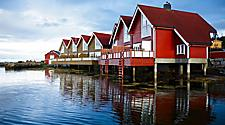 Red homes on the water in Molde, Norway