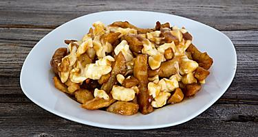 Poutine, a Quebecois meal of french fries and cheese curds with gravy, from a restaurant in Montreal, Quebec
