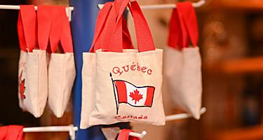 Tote bags with the Canadian flag for sale in a souvenir shop in Montreal, Quebec