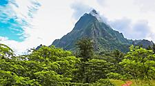 View of the interior landscape and towering mountain peak in Moorea Island, French Polynesia