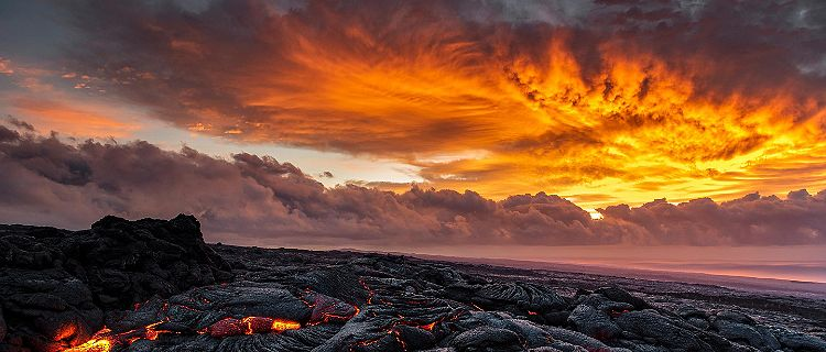 Lava flow entering the ocean from the Kilauea volcano in Mount Kilauea, Hawaii