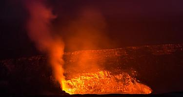 Sea view of the glowing lava from the Kilauea volcano in Mount Kilauea, Hawaii