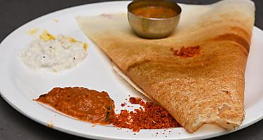 Masala dosa with potato stuffed inside, very popular breakfast in Mumbai, India