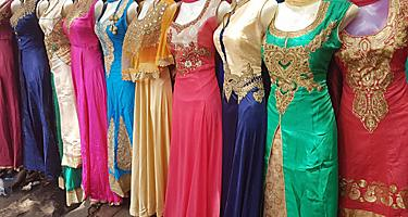 Colorful traditional Indian dresses selling at the street vendors in Mumbai, India