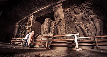 Statues inside the Elephanta Caves in Mumbai, India