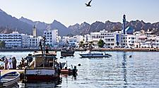 Fishermen with their boats on the docks of Muscat, Oman