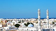 Views of the city of Muscat, Oman with clear skies and views of mosques and city buildings