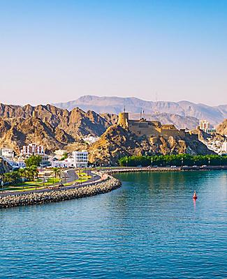 View of the waterfront coast with mountains in Muscat, Oman