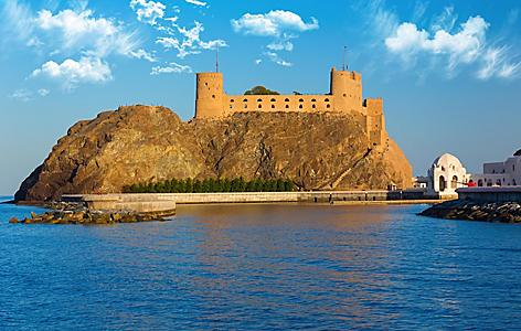 Impressive twin forts called Fort Al-Jalali at the entrance of Old Muscat's harbor near Sultan Qaboos palace in Muscat, Oman