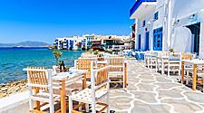 Chairs with tables in typical Greek tavern in Mykonos, Greece