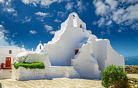 A beautiful old white chapel, the Panagia Paraportiani Church, in Mykonos, Greece