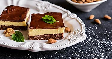 A white plate with two Nanaimo bars