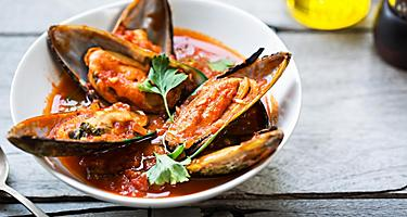 Mussels in tomato and herb sauce in New Zealand
