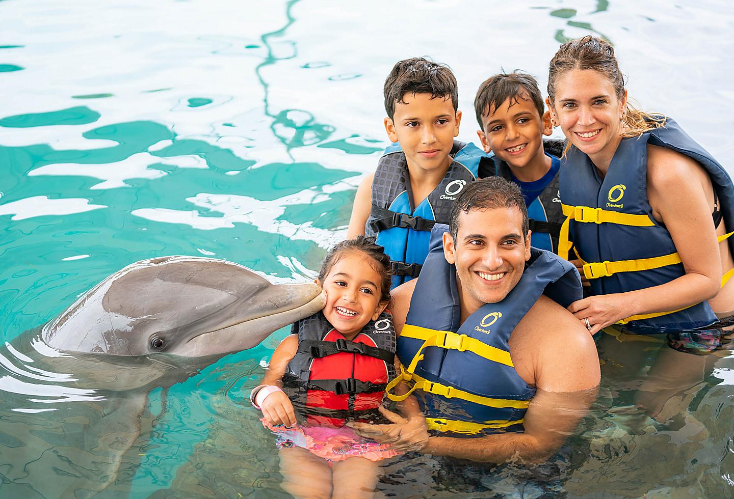 Family Posing with a Dolphin