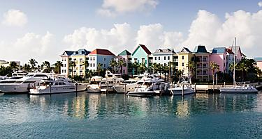 Boats docked at the pastel colored Marina Village, Nassau, Bahamas
