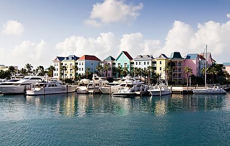 Boats docked at the pastel colored Marina Village, Nassau, Bahamas