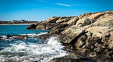 Waves crashing on a rocky coast in Newport, Rhode Island