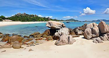 The Bai Dai beach will large rocks on the shore in Cam Ranh, Vietnam