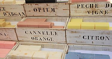 An assortment of scented soaps in wooden crates for sale in France