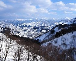 View of the snow mountain range from a gondola during Winter in Niigata, Japan