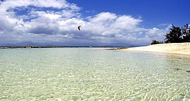 Kiteboarding over the beach in Noumea, New Caledonia