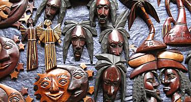 Decorative wood carving artifacts in a gift shop.