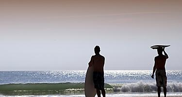 Surfer's Standing Beach Waves, Orlando, Florida