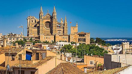 The Palma de Mallorca, Spain cityscape with La Seu cathedral towering over the city