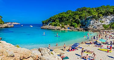 People enjoying Cala Llombards beach in Palma de Mallorca, Spain