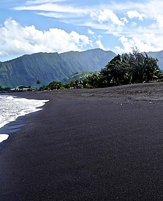 A black sand beach in Papeete, Tahiti