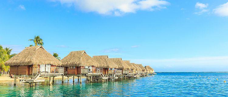 Over the water tiki huts in a beautiful resort in Papeete, Tahiti