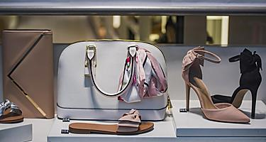 A typical designer storefront in Paris, France displaying shoes and handbags