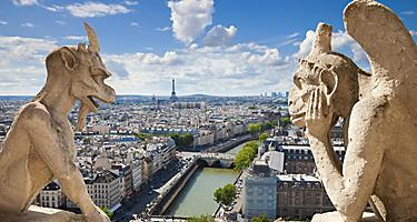Famous gargoyles overlooking the city of the Paris, France