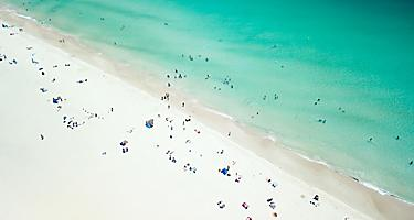 An aerial viw of Leighton Beach with lots of beach goers enjoying the day in Perth