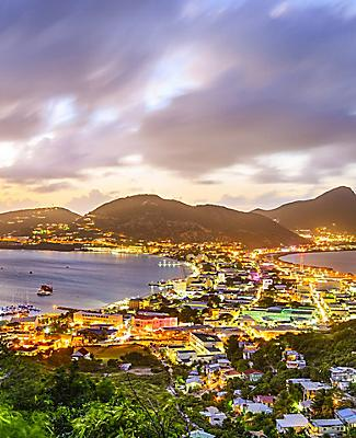 Great Salt Pond at sunset with city lights illuminating downtown Philipsburg, St. Maarten