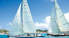 Sailboats racing in the Regatta through the crystal clear waters of Philipsburg, St. Maarten