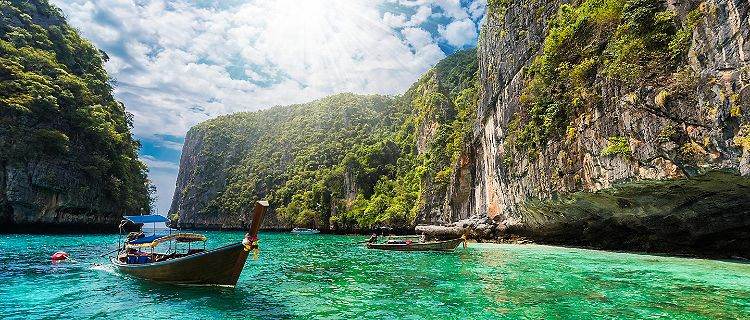 Beautiful landscape with traditional boat on the sea in Phi Phi Lee region in Phuket, Thailand