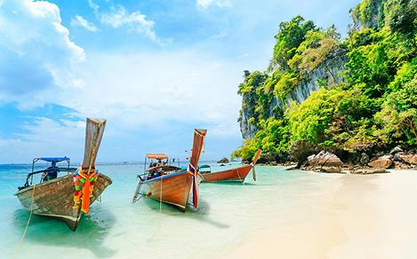 Longtale boat on the white beach at Phuket, Thailand
