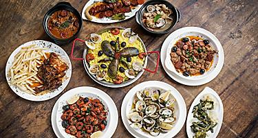 Mixed Portuguse tapas on wood table