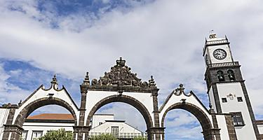 Portas de Cidade and the Saint Sebastian church clock tower in Ponta Delgada, Azores