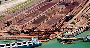 Sand piles and cargo ships at Port Hedland, Australia
