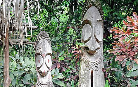 Two wooden tam tamsin from tree trunks in Port Vila, Vanuatu