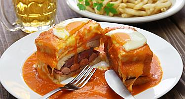 Homemade francesinha, sandwich with ham and sausage, from a restaurant in Porto, Portugal