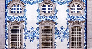 Traditional historic facade in Porto, Portugal, decorated with blue hand painted tin-glazed tiles