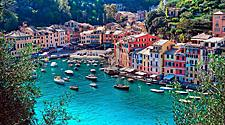 Colorful houses and yachts along the coast of Portofino, Italy