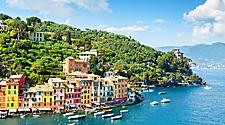 Beautiful sunny day with colorful houses on the coast of Portofino, Italy