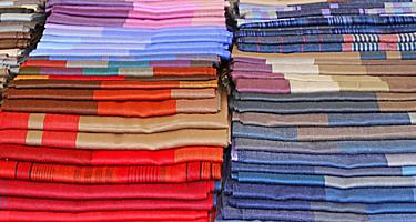 Scarves and fabrics for sale in a shop in Portofino, Italy