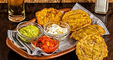 Tostones or patacones, fried green plantain slices, typical in Puerto Limon, Costa Rica
