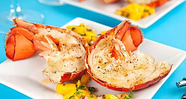 Grilled lobster with fresh mangos is the local cuisine in Punta Cana, Dominican Republic