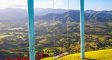 Views from the top of Montana Redonda in Punta Cana, Dominican Republic where you can find a swing set on the mountain top